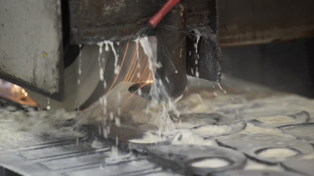 Metal grinding machine. Industrial concept grinding metal with sharp sparks. Grinding smooths steel and iron using modern equipment. Machinery and professional equipment concept. Close up shot video
