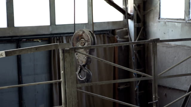 Metal hook industrial hoists video