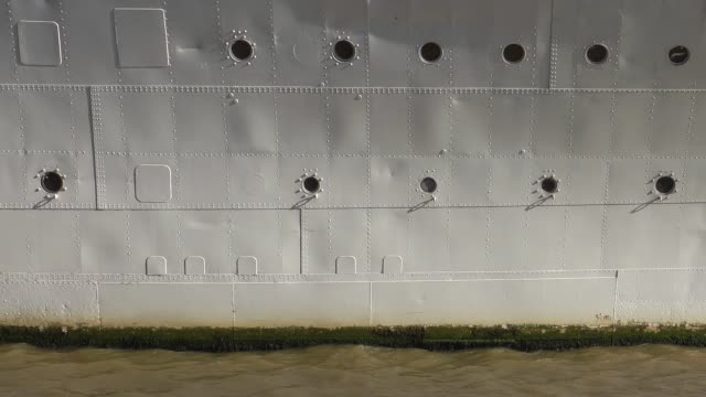 Metal hull of a ship moored on the Thames. - vídeo
