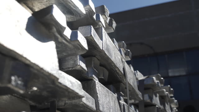 Metal ingots in Aluminium foundry for Aluminium extrusion production.. Billets for aluminium profile production at a metallurgical plant. video