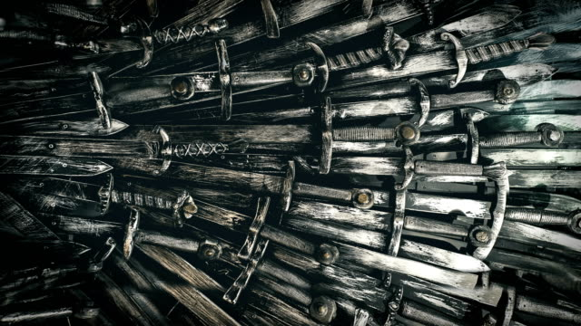 Metal knight swords background. Close up. The concept Knights. 4K.