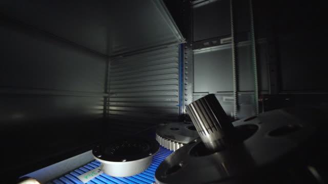 metal parts traveling in big automatic warehouse. - lega metallica video stock e b–roll