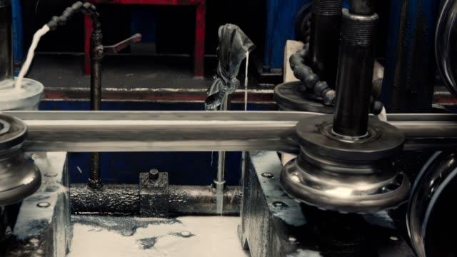 vídeos de stock e filmes b-roll de metal profile forming machine. sheet metal processing. - aço