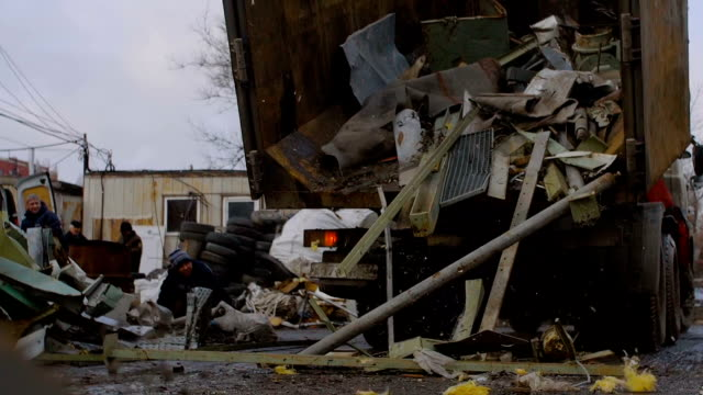 Metal Scrap Drops Out From The Truck for Recycling video