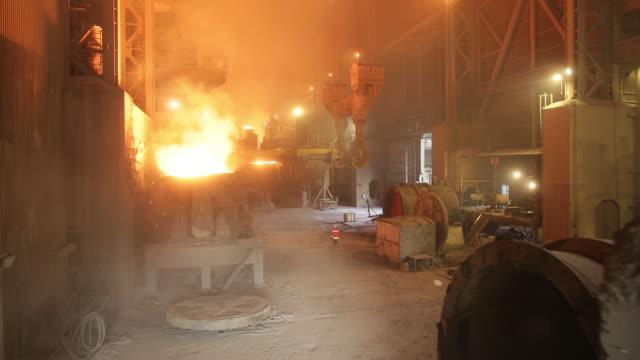 Metal smelting furnace in steel mills/Canakkale. Canakkale/Turkey 11/11/2014 Metal smelting furnace in steel mills/Canakkale. Canakkale/Turkey 11/11/2014 foundry stock videos & royalty-free footage