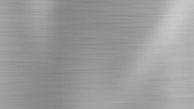 vídeos de stock e filmes b-roll de metal texture background with light effect stock video - cromo metal
