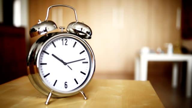 Metal vintage alarm clock counting video