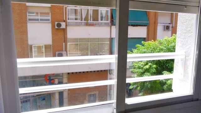 Metal window shutters move down
