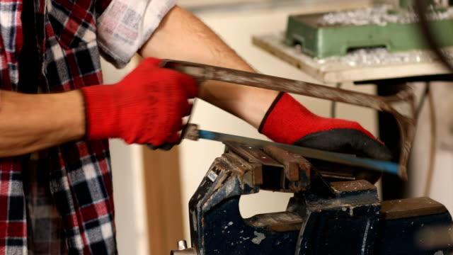 Metal worker in small workshop video