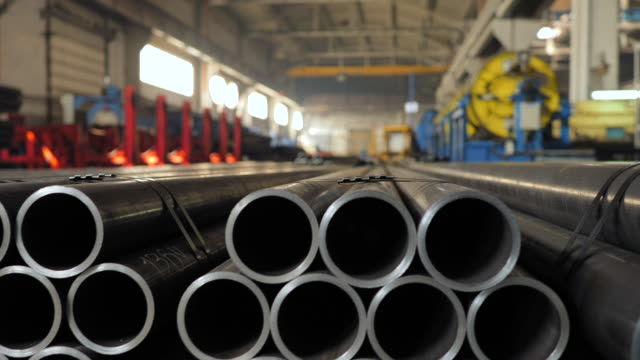 Metallic pipes on warehouse, rows of metal pipes on industrial warehouse. Industrial interior, Metalic pipes on warehouse, rows of metal pipes on industrial warehouse. Industrial interior, iron metal stock videos & royalty-free footage