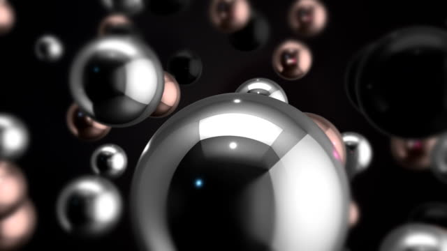 Metallic Reflective Spheres Moving Slowly On Dark Background video