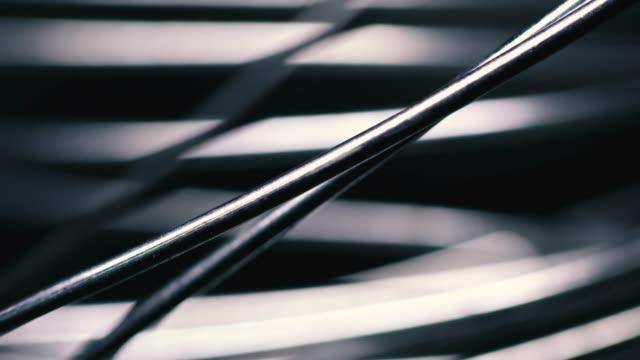 metallic wire tangled on black background - cavo d'acciaio video stock e b–roll