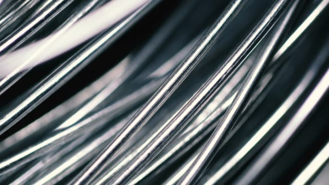 metallic wire tangled on black background - flessibilità video stock e b–roll