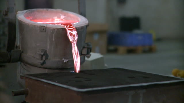 Metallurgical industrial factory: pouring melted metal