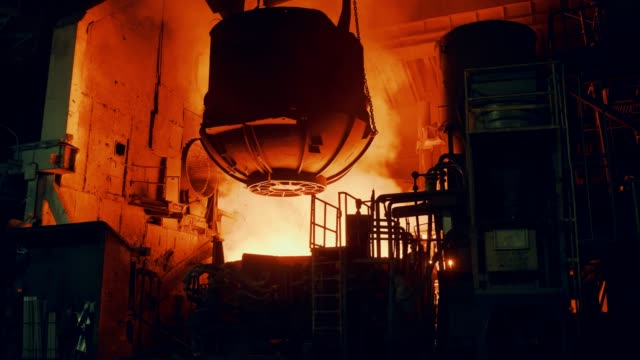 metallurgical plant - the furnace is filled with scrap metal - attrezzatura energetica video stock e b–roll