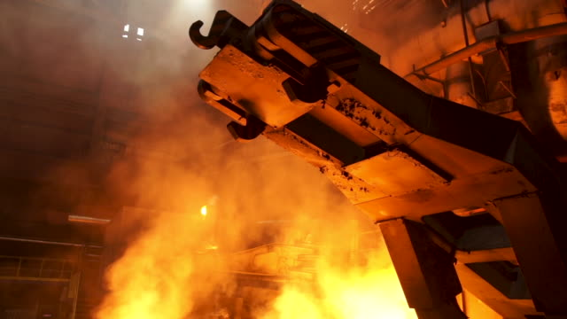 metallurgical production, equipment at the hot workshop at the plant, heavy industry, engineering. stock footage. view inside of the steelmaking factory - aluminium filmów i materiałów b-roll