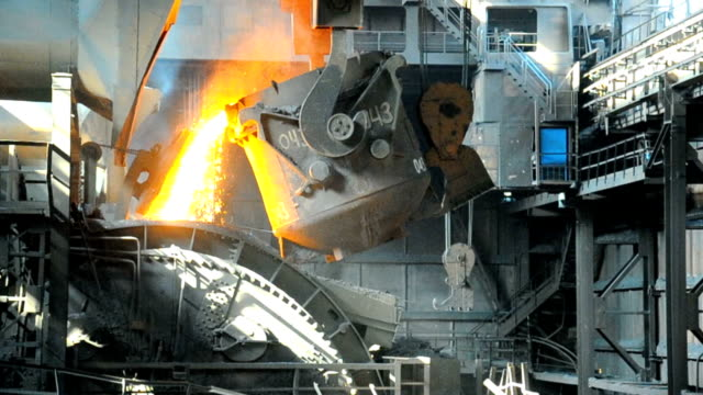 metallurgical works molten metal poured from ladle into mold at steel plant furnace stock videos & royalty-free footage