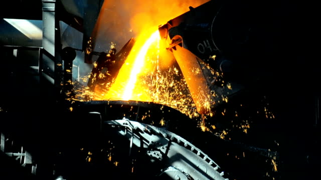 metallurgical works molten metal poured from ladle into mold at steel plant steel mill stock videos & royalty-free footage