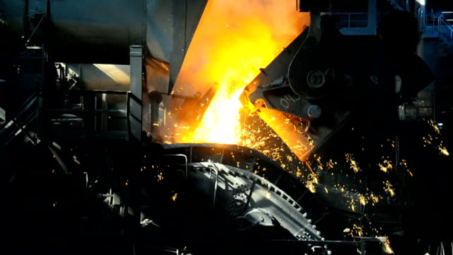 metallurgical works molten metal poured from ladle into mold at steel plant metallurgy stock videos & royalty-free footage