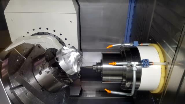 Metalworking CNC milling machine. Metalworking CNC milling machine. Cutting metal modern processing technology. metal worker stock videos & royalty-free footage