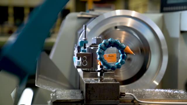 metalworking steel gears by worker in a factory. - lega metallica video stock e b–roll