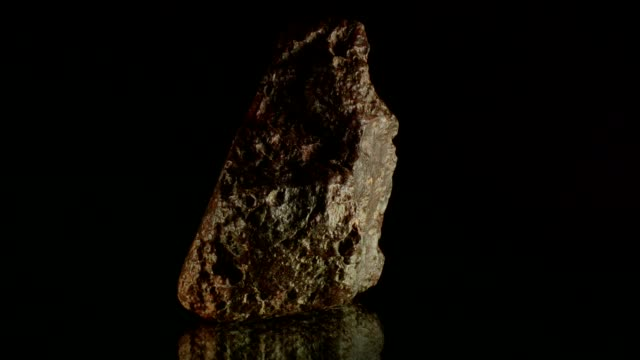 Meteorite rotating on black Meteorite rotating on black, reflecting background iron metal stock videos & royalty-free footage