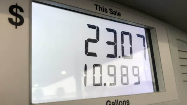 Meter on pump at gas station showing dollars and gallons