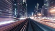 istock T/L POV Metro Riding through Downtown at Night / Dubai, UAE 1226449787