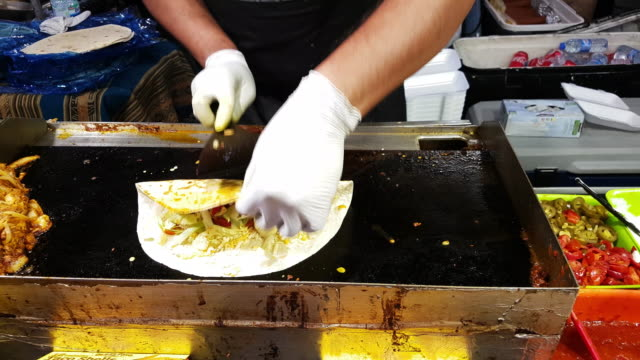 Mexican Burrito Being Prepared On Food Market video