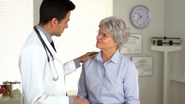 Mexican doctor talking with mature woman patient video
