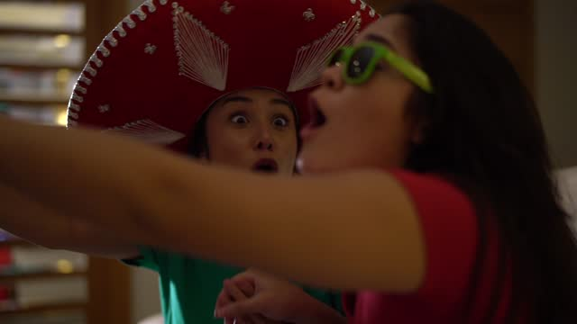 Mexican fan celebrating at home
