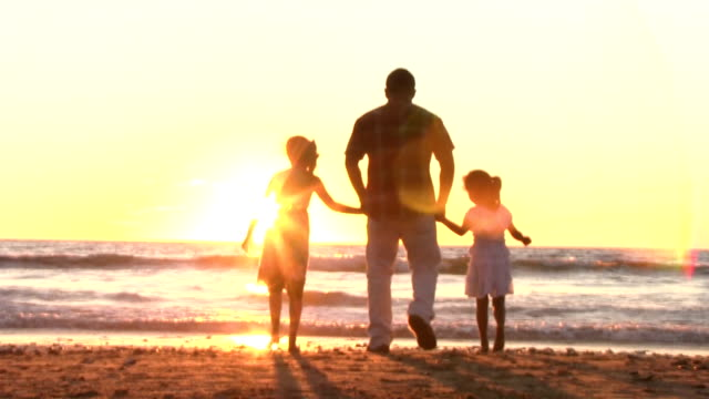 Mexican father with his daughters sunstream defocus spinning at sunset video