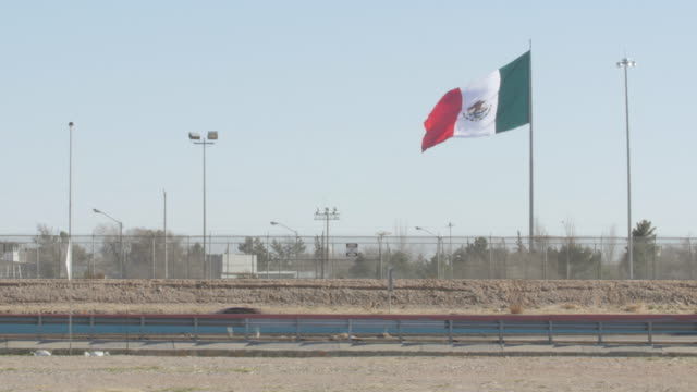 Mexican Flag Waving Near the US and Mexico Border and Highway video