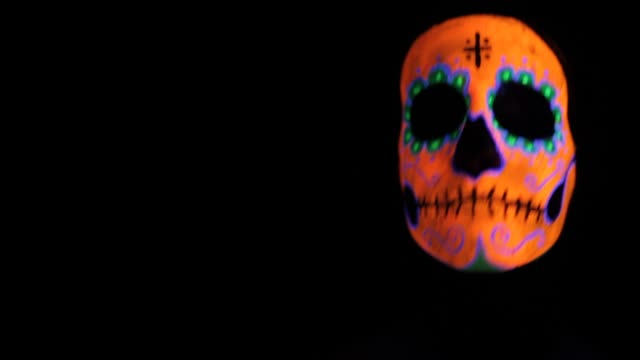 Mexican Skull Funny Dance A floating skull is dancing on a black background. It´s a UV make-up on a woman. Blcak Background is easy to blend by screen mode, and is easy also to scale and change the colours. carnival celebration event stock videos & royalty-free footage