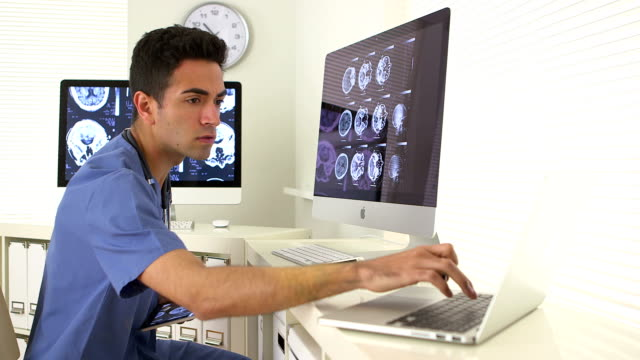 Mexican surgeon reviewing brain scans of patient Mexican surgeon reviewing brain scans of patient radiologist stock videos & royalty-free footage