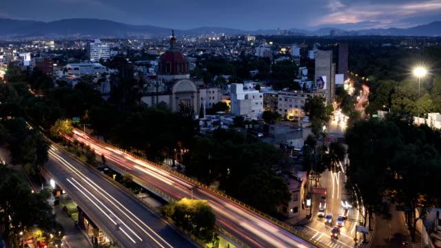 mexico city dusk time lapse - город мехико стоковые видео и кадры b-roll