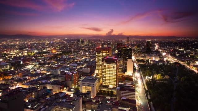 время lapse: город мехико закате - город мехико стоковые видео и кадры b-roll