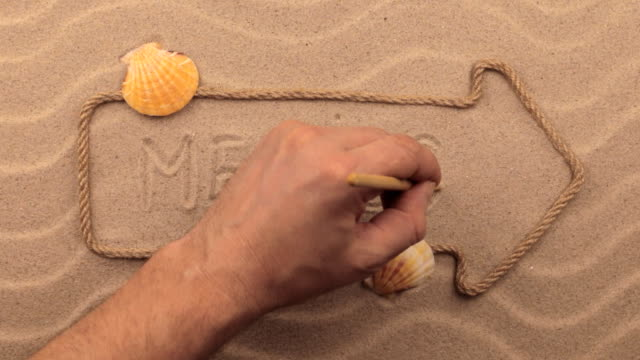 Mexico inscription written by hand on the sand, in the pointer made from rope. video