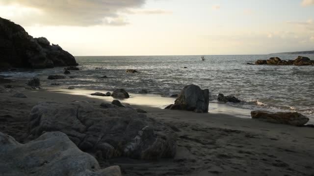 Mexico, Oaxaca, Puerto Escondido, rock in the zicatela beach