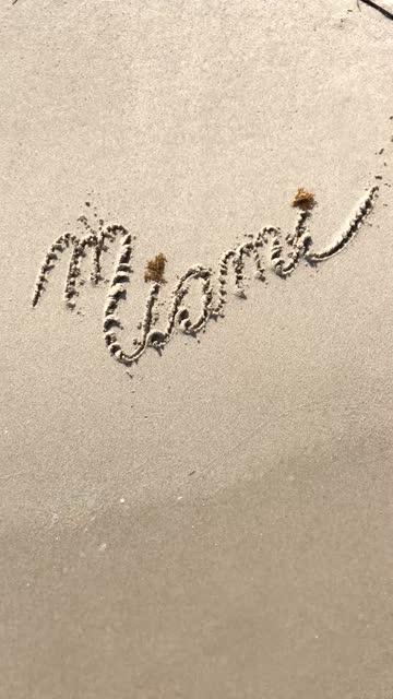 Miami Beach sand sign message handwritten