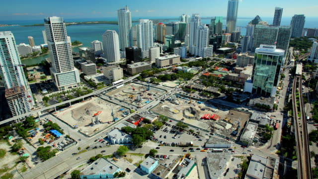 Miami time lapse Skyscrapers of Miami, Midtown, day time lapse. Constractions sites at the bottom of the frame. Camera movement tilt up and right. Blue sky and ocean. crane construction machinery stock videos & royalty-free footage
