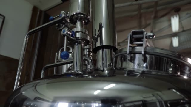 Microbrewery equipment. Close up tanks in brewery warehouse. Metal brewery vessels. Small business concept Microbrewery equipment. Close up tanks in brewery warehouse. Metal brewery vessels lager stock videos & royalty-free footage
