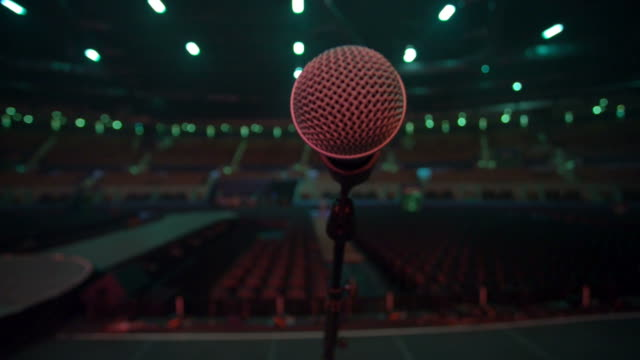 Microphone from the stage to an empty auditorium, red tones video