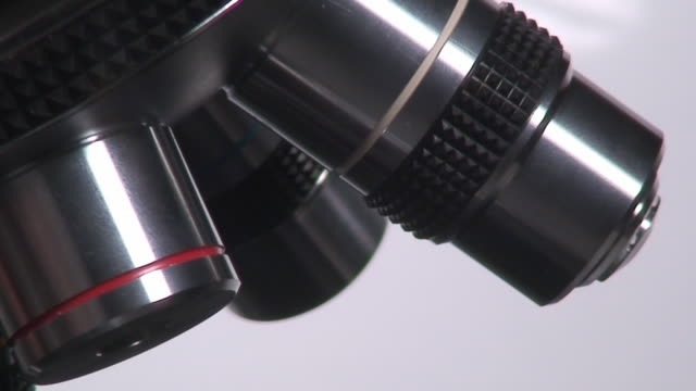 Microscope macro spining Microscope lenses in macro shot rotating and moving the slide high scale magnification stock videos & royalty-free footage