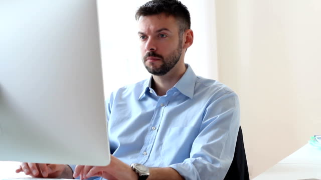 Mid adult businessman at work video