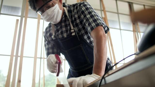 Mid adult Man working Carpenter on workshop