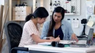 istock Mid adult mom helps teenage daughter with homework 1150570188