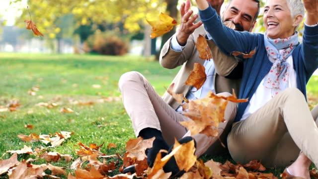 mid aged couple having fun in a park. - krótkie włosy filmów i materiałów b-roll