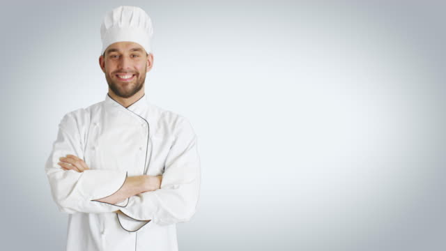 Mid Shot of a Handsome Chef Crossing Arms and Smiling. Shot with White Background. video