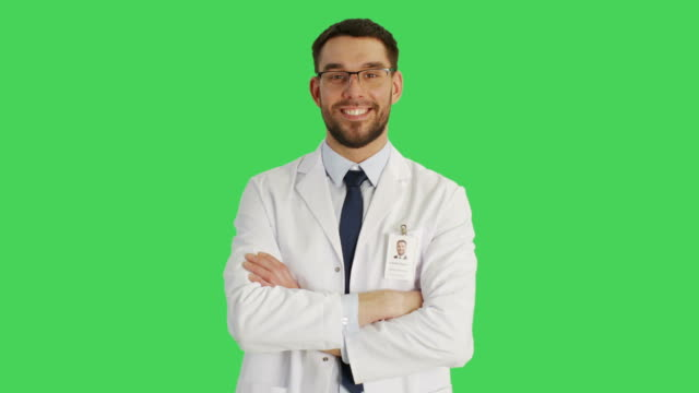 Mid Shot of a Handsome Doctor/ Scientist Wearing Glasses Crossing Arms and Then Pointing his Index Finger Upwards. Background is Green Screen. video